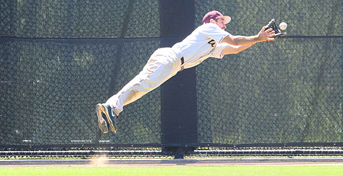 Diving catcch in right field by Chito Elias. Photo copyright by Bernie Derke
