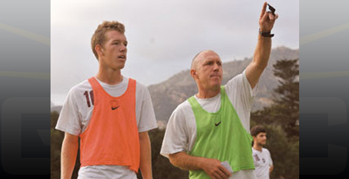 Westmont soccer player Tanner Wolf, (left) stands next to his father Dave, the team's head coach, during a training session.