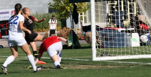 Brooke Lillywhite scores one of her record-setting five goals.