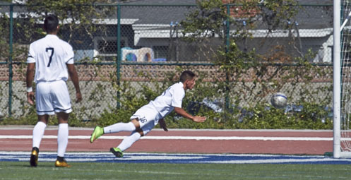 Raul Pinon scored two goals on Saturday including this diving header (Photo by Liza Rosales)
