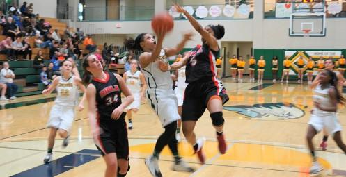 Senior Carlisha Phillips goes up against Biola.